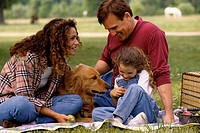 Parents with their daughter and a dog