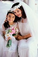 Bride smiling with a flower girl