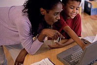 Mother and her son in front of a laptop