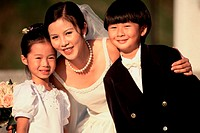 Portrait of a bride with a flower girl and a ring bearer