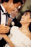 Close-up of a newlywed couple dancing