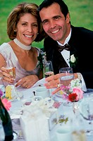 Portrait of a newlywed couple holding glasses of champagne