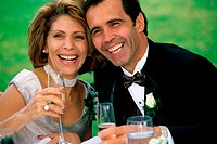 Close-up of a newlywed couple drinking champagne