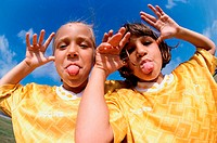 Portrait of two girls making faces (thumbnail)