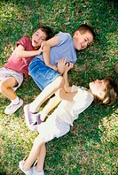 High angle view of a girl and two boys playing in a park