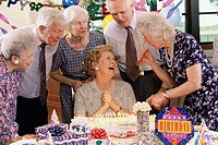 Group of senior people celebrating at a birthday party