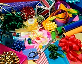 High angle view of ribbons with wrapping paper and a pair of scissors