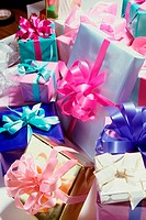 Pile of wrapped gifts with bows