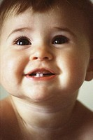 Close-up of a baby boy smiling