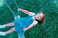 High angle view of a girl sitting on a swing