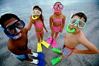 High angle view of a group of children wearing snorkels and flippers