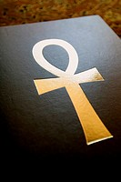 Close-up of ankh symbol on a book