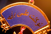 Close-up of an Islamic good luck charm