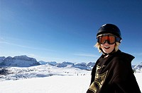 young snowboarder with mountains in background