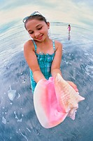 Girl holding a conch shell