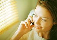 Woman using cell phone, close-up