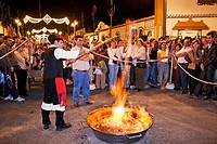 Preparing ´queimada´ (Galician traditional hot alcoholic drink) during folk festival in Fuengirola. Málaga province, Costa del Sol. Andalusia, Spain