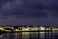 High angle view of buildings on the waterfront lit up at night, Hersonissou, Crete, Greece