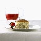 Poppy seed soufflé with strawberry sauce