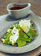 Mangetout pea salad with honey, nuts and pecorino shavings