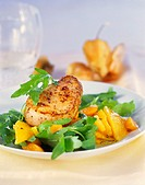 Pork fillet on rocket with physalis and oranges