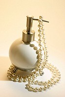 Pear necklace and lotion dispenser
