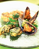 Spinach fritters and mussels cooked in white wine