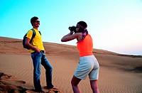 Western tourist couple in the desert near Hatta, United Arab Emirates