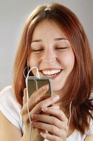 Young woman, 25, laughing while listening to her Ipod