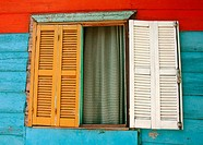 Painted house and old shutters, La Boca district. Buenos Aires, Argentina