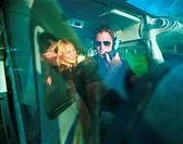 pilot in small propeller plane talking to female passengers