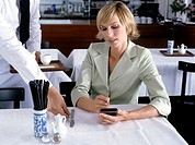 businesswoman working with pda in restaurant