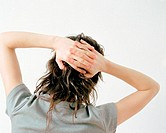 Woman with hands behind head (thumbnail)