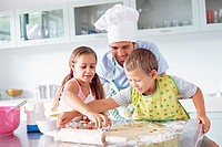 Father and children baking