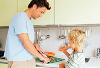 Boy and father preparing carrots