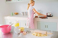 Woman baking in kitchen