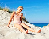 Girl sitting on a sand dune (thumbnail)