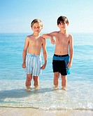 Two boys standing in the sea (thumbnail)