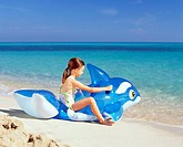 Girl on inflatable whale