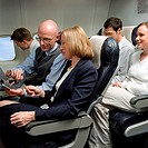 Business people on an aeroplane