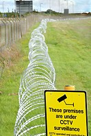 Razor wire and CCTV sign on protected premises