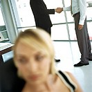 Businessmen shaking hands in office (thumbnail)