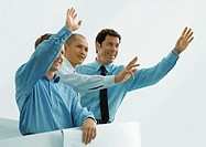 Three businessmen waving