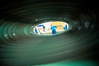 Manual worker, seen through tube