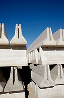 Cement construction barricades stacked for use on interstate highway roads