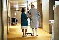 Nurse in a medical facility assists an elderly patient with his walking exercise in San Francisco, California.