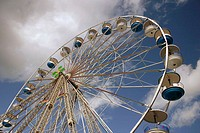 Parts of bigwheel with cloudy sky. Weterpark Kermis. Amsterdam. Holland