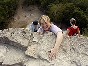 Tourists climbing the Temple of the Churches in Coba, ruined city of the Pre-Columbian Maya civilization (600 A.D.). Quintana Roo, Mexico