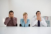 three office workers doing hear no evil see no evil speak no evil