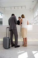 business couple standing at reception in office building